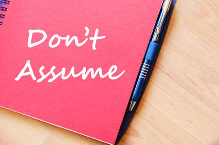 assumption: Dont assume text concept write on notebook with pen