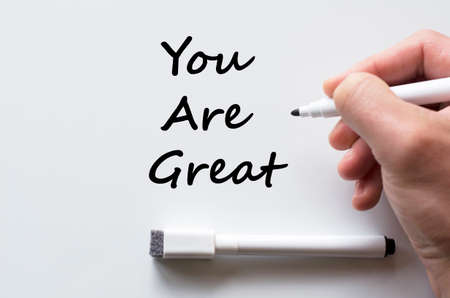 exaltation: Human hand writing you are great on whiteboard Stock Photo