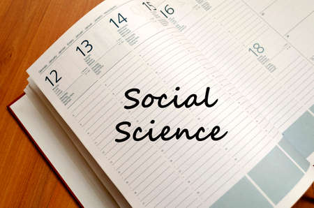 science text: Social science text concept write on notebook