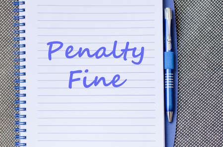 prosecute: Penalty fine text concept write on notebook with pen
