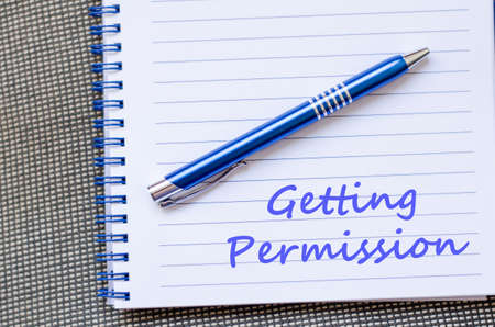 Getting permission text concept write on notebook with pen Banque d'images
