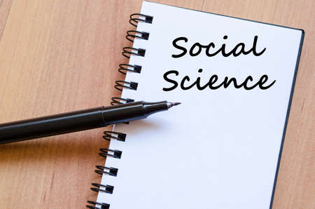 science text: Social science text concept write on notebook with pen