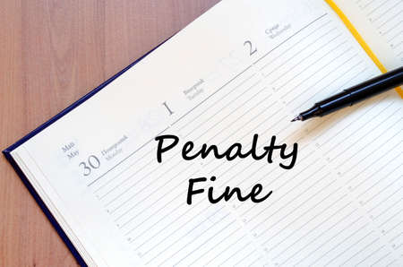 forfeiture: Penalty fine text concept write on notebook with pen