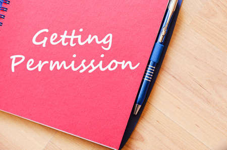 permission: Getting permission text concept write on notebook with pen Stock Photo