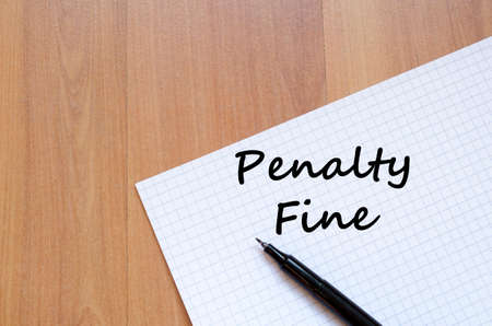 parking violation: Penalty fine text concept write on notebook with pen