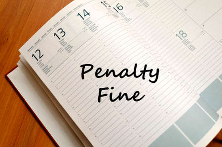 forfeiture: Penalty fine text concept write on notebook