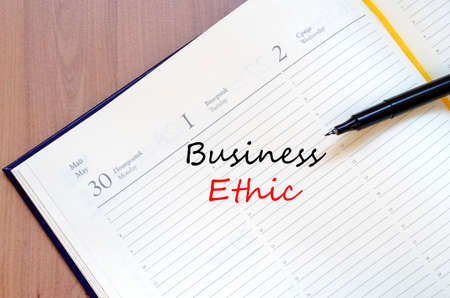 working ethic: Business ethic text concept write on notebook