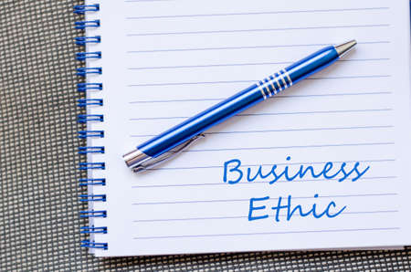 ethic: Business ethic text concept write on notebook