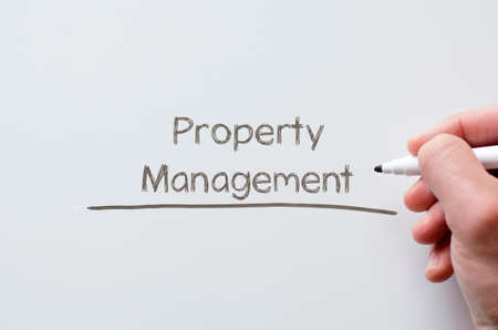 property management: Human hand writing property management on whiteboard