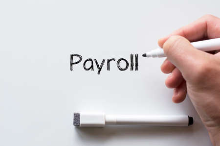 payroll: Human hand writing payroll on whiteboard Stock Photo