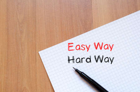 hard way: Easy way hard way text concept write on notebook