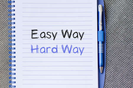 difficult lives: Easy way hard way text concept write on notebook