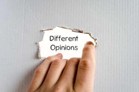 differing: Different opinions note in business man hand Stock Photo