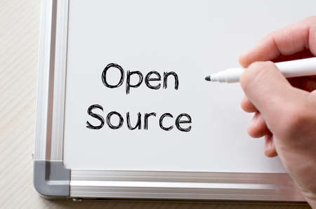 open source: Human hand writing open source on whiteboard