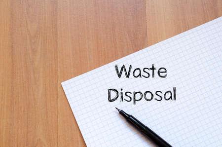 hazardous waste: Waste disposal text concept write on notebook Stock Photo