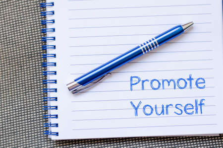 promote: Promote yourself text concept write on notebook