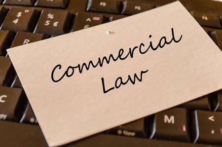 commercial law: Commercial law - note on keyboard in the office