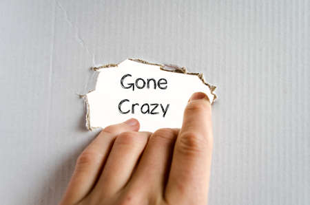 gone: Gone crazy note in business man hand