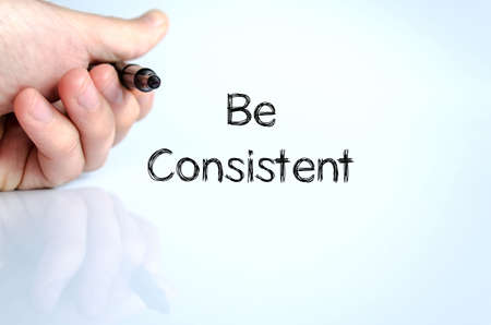 Be consistent note in business man hand Stock fotó