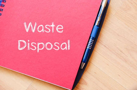 waste disposal: Waste disposal text concept write on notebook Stock Photo