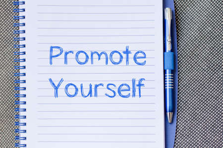 facilitate: Promote yourself text concept write on notebook