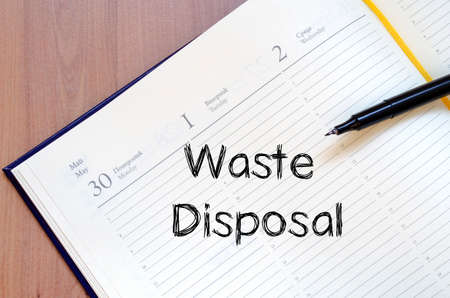 disposal: Waste disposal text concept write on notebook Stock Photo