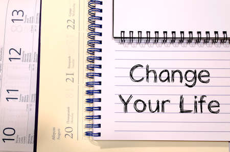take charge: Change your life text concept write on notebook