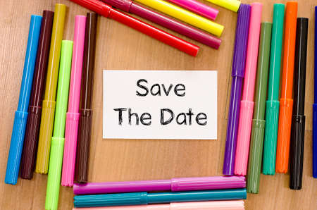 appoint: Save the date text concept and colored pens