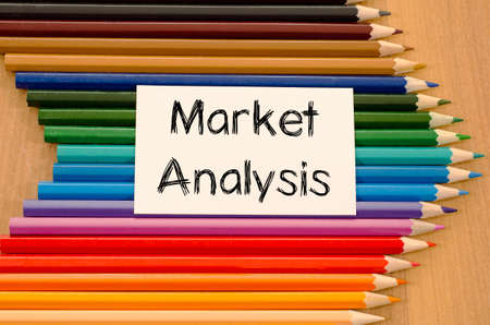 delineation: Market analysis text concept and colored pencil on wooden background Stock Photo