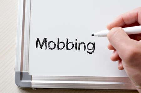 mobbing: Human hand writing mobbing on whiteboard
