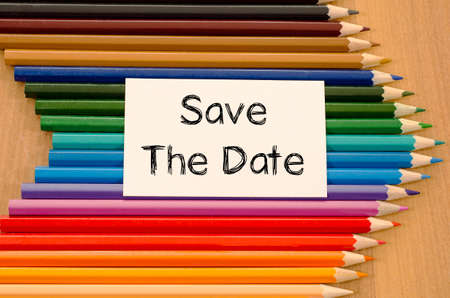 appoint: Save the date text concept and colored pencil on wooden background