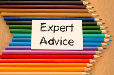 tenet: Expert advice text concept and colored pencil on wooden background Stock Photo