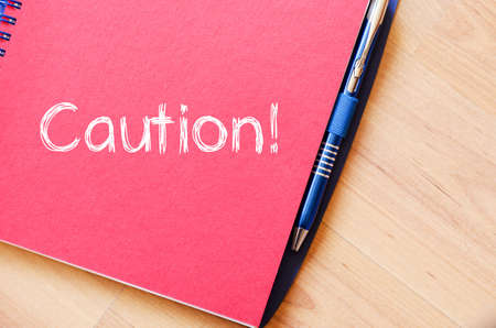 safety slogan: Caution text concept write on notebook Stock Photo