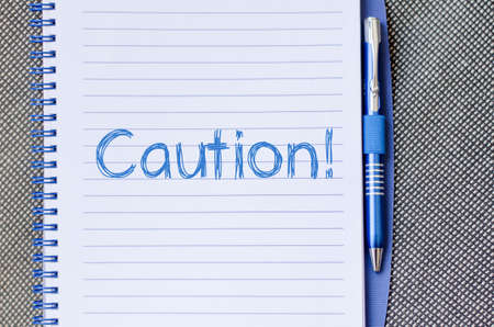 forewarn: Caution text concept write on notebook Stock Photo