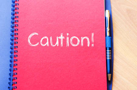 janitorial: Caution text concept write on notebook Stock Photo