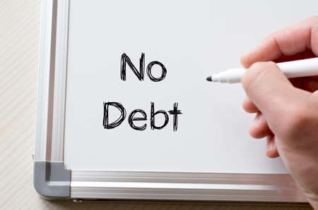 debt goals: Human hand writing no debt on whiteboard