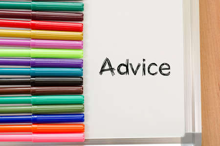 color consultant: Advice text, Felt-tip pen and whiteboard on a wooden background Stock Photo
