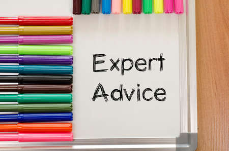 tenet: Expert advice text, Felt-tip pen and whiteboard on a wooden background Stock Photo