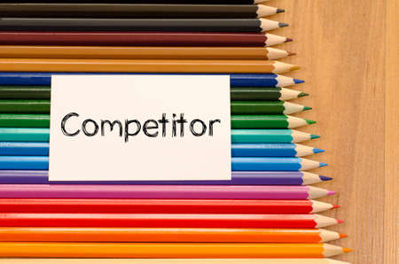 competitor: Competitor text concept and colored pencil on wooden background