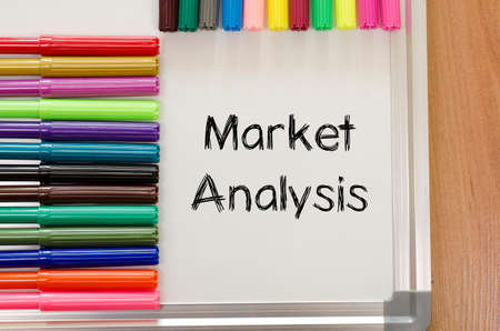 delineation: market analysis text, Felt-tip pen and whiteboard on a wooden background Stock Photo