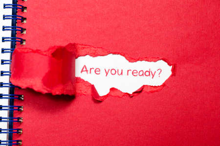eagerness: The word are you ready appearing behind torn paper.