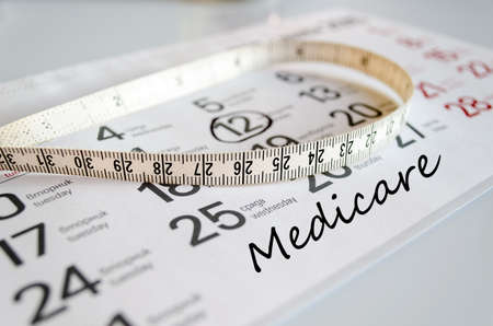 health care provider: Medicare text concept over tape measure and calendar background