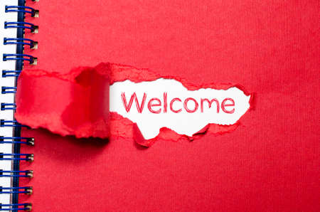 meet and greet: The word welcome appearing behind torn paper. Stock Photo