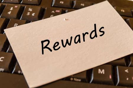 compensate: Rewards concept on black keyboard background
