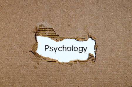 insanity: The word psychology appearing behind torn paper. Stock Photo