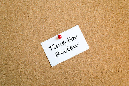 reassessment: Sticky Note On Cork Board Background And Text Concept Stock Photo