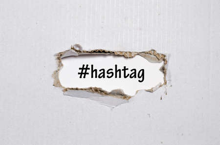 metadata: The word hashtag appearing behind torn paper