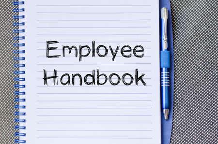 Employee handbook text concept write on notebook