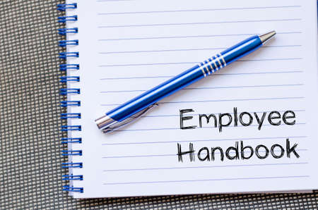 Employee handbook text concept write on notebook
