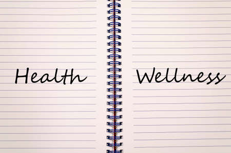 Health And Wellness Text Concept Write On Notebook Stock